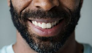 Closeup of man's smile - Dental Implants Pinole, CA