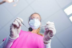 Dentist holding tools in hands - Dental Anesthesia Pinole, CA