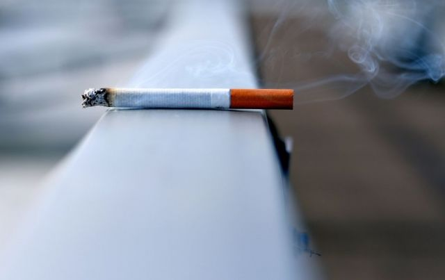 A cigarette lying on a ledge - Pinole Oral Surgery, CA