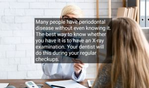 Female doctor looking at a patient's x-rays because of periodontal disease, with text - Pinole Oral Surgery, CA